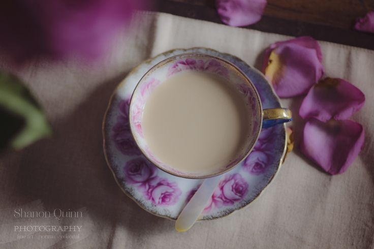 """shanonquinnphotography.com """"Drop Away"""". Tea cup with roses, coffee table."""