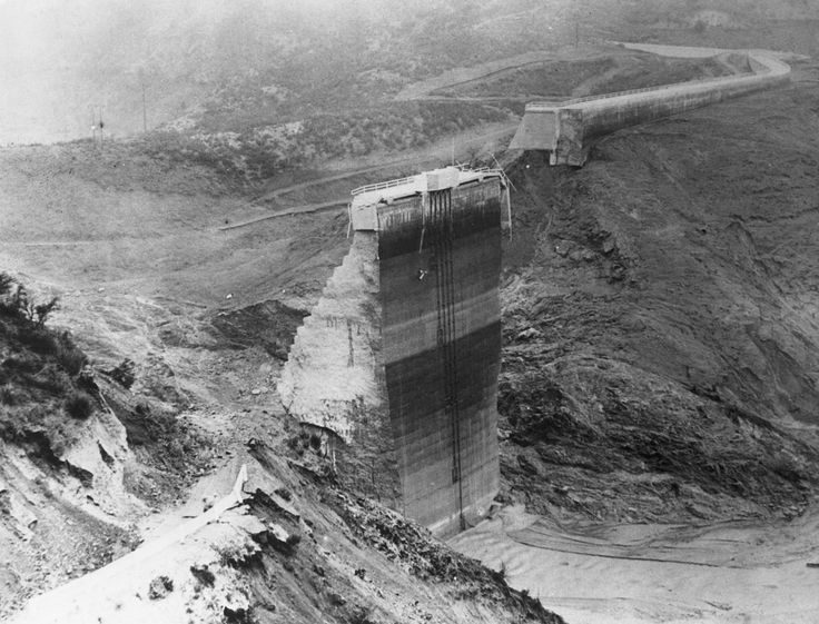 The St. Francis Dam in California, pictured after it collapsed in 1928, spewed 12.4 billion gallons of water that rose 140 feet, surging 54 miles to the Pacific Ocean.