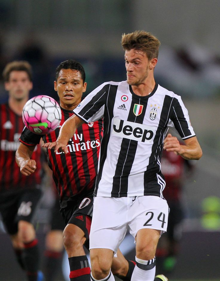 Daniele Rugani (R) of Juventus FC competes for the ball with Carlos Bacca of AC Milan during the TIM Cup final match between AC Milan and Juventus FC at Stadio Olimpico on May 21, 2016 in Rome, Italy.