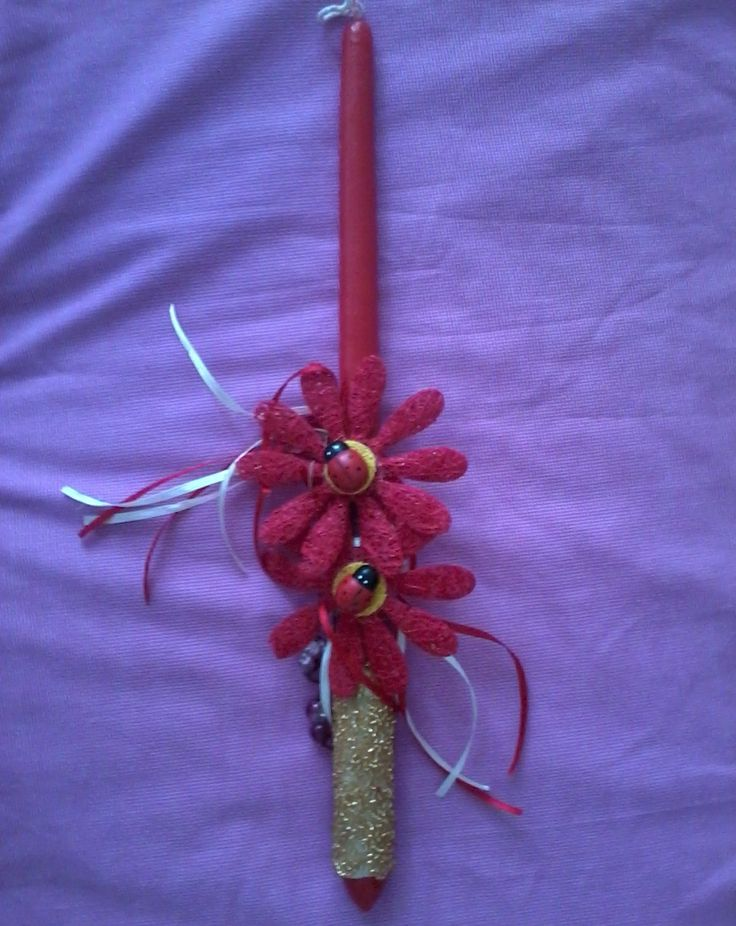 Easters' symbol in Greece are the ladybugs, so this is a traditional Greek Easter candle ......