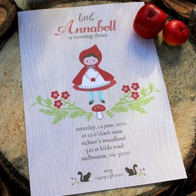 Little Red Riding Hood party invite with wood grain background.