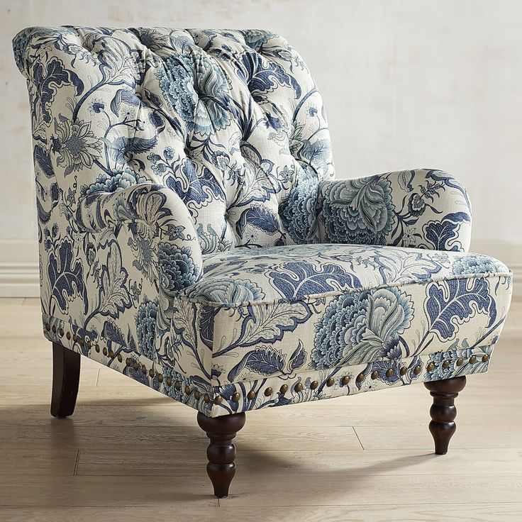 Take a seat in a flowering meadow, offered here in a timeless silhouette. Overstuffed and tufted, this handcrafted armchair comes with vintage charm to spare: Rolled back and arms, ornamental nailhead trim, self-welting and turned hardwood legs.