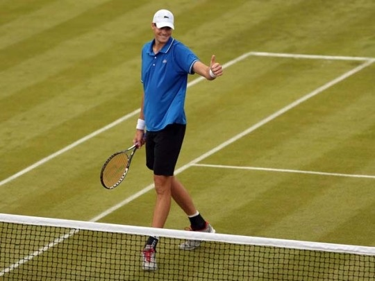 John Isner of the United States reacts after defeating Olivier Rochus of Belgium during the men's singles tennis match on day one of the London 2012 Olympic Games at the All England Lawn Tennis and Croquet Club in Wimbledon on July 28, 2012, in London.