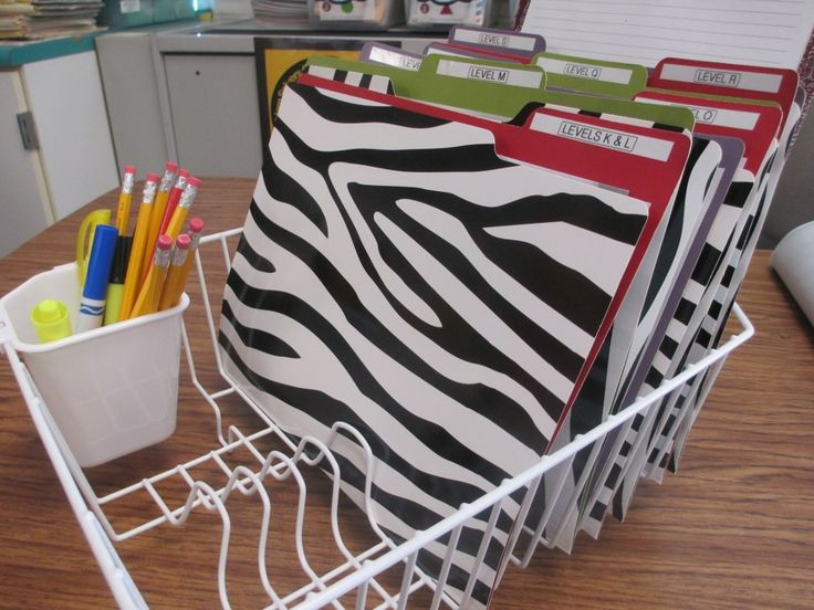 Dish rack for guided reading organization...then use a file folder to store each book, with lesson plan taped to inside of folder and extra copies stored inside folder