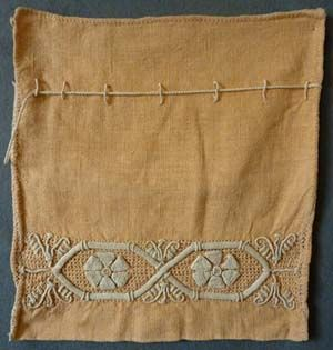 Castelguidi embroidered apricot linen bag, Italian, c. 1900. This style of embroidery is sometimes called Casalguidi. The town of Castelguidi is near Pistoia in Italy. They were producing this type of work from the late 1800's until World War I.