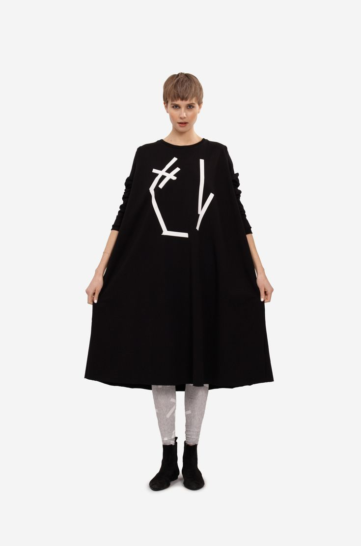 """MAXI SWEATSHIRT """"ABSTRACT"""" Shorthaired model wearing a maxi sweatshirt or dress with long sleeves and original print. Dress are combined with original printed leggings."""