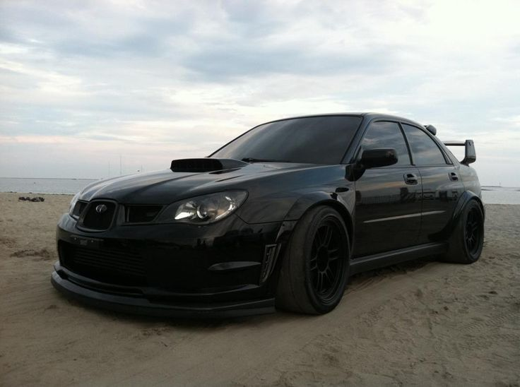 Oh my gosh this is soooo sexy. Love the blacked out subaru STI WRX. Looks badass.