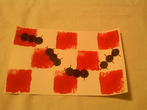 Preschool craft.  Ants at a picnic.  Used square cut from kitchen sponge for the checkered background (tip: wet sponge and squeeze out water so it will be soft for sponging paint on) and did the ants with eraser at end of a extra large kid-pencil.