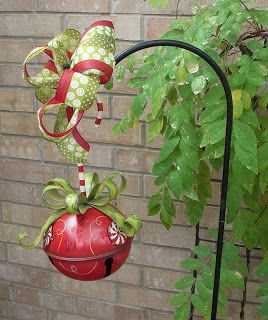 Shepherds hook with either a bell or a large ornament from the dollar store.  Add bows.  Easy decorating.