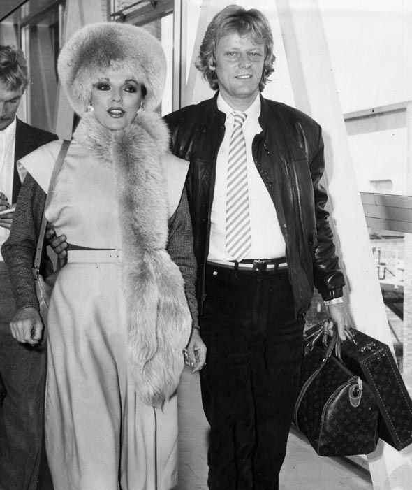 Joan Collins and Peter Holm at Heathrow Airport in 1984