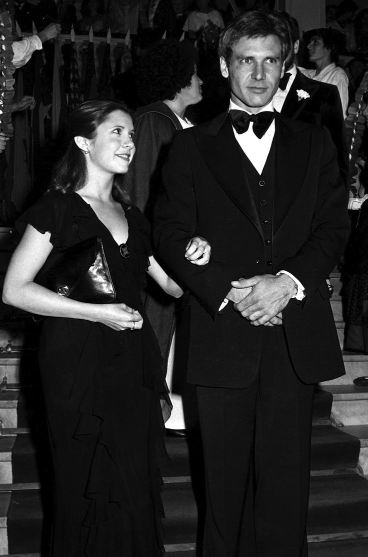 Harrison Ford and Carrie Fisher at the premiere of STAR WARS (1977)