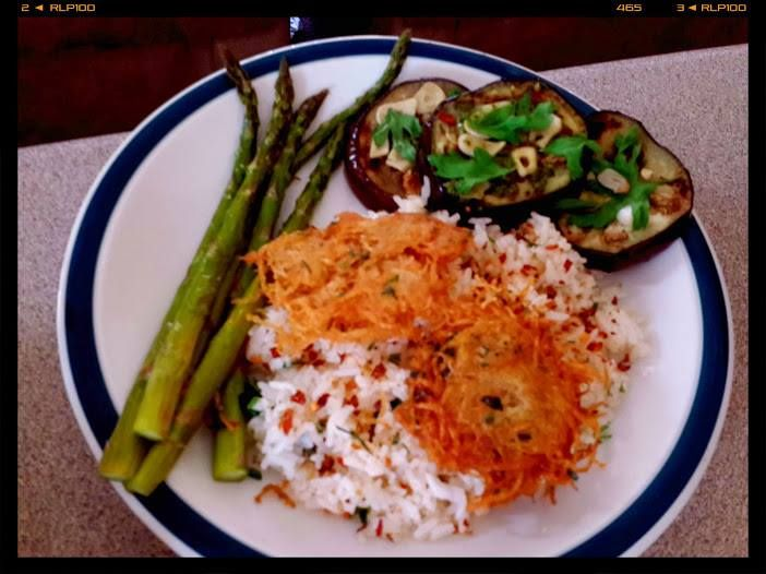 Herbed rice, crispy potato cakes, pesto eggplants, lemon-zest asparagus
