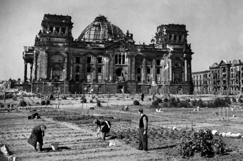 Berlin, Germany, 1946. In the background the Reichstag in ruins; in the foreground a small collective garden at the destroyed Tiergarten