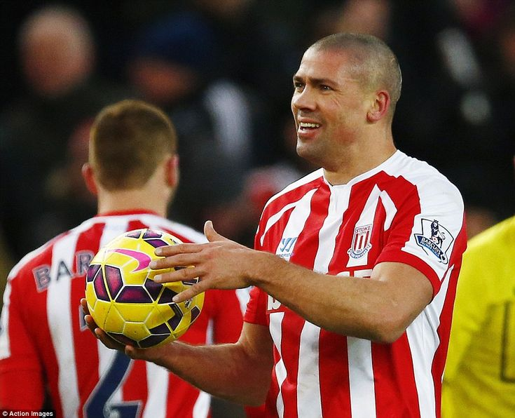 Match ball: Jonathan Walters collects the ball with a smile having bagged three goals agai...