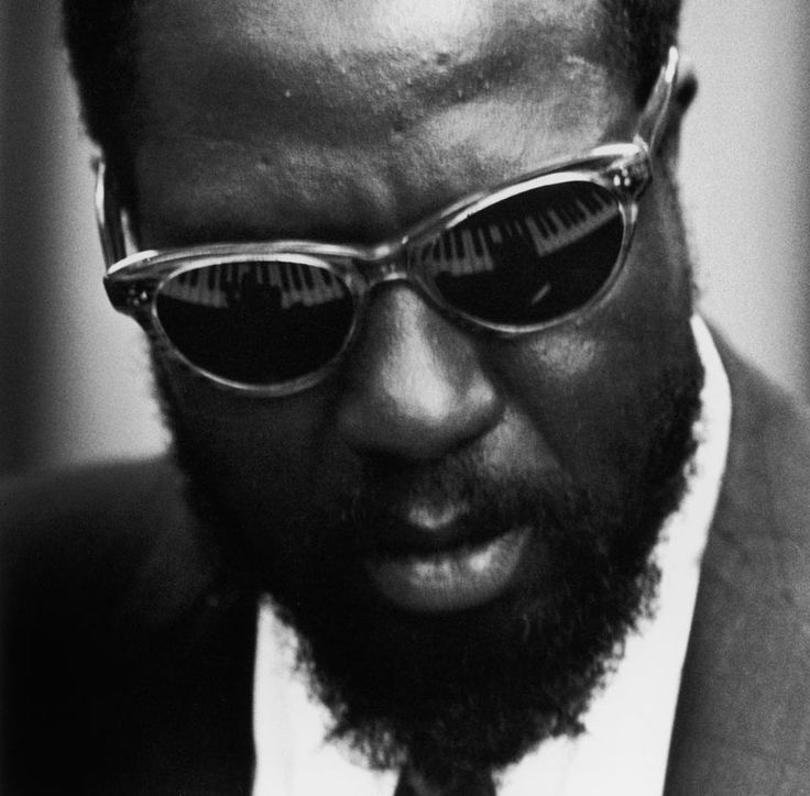 Thelonious Monk's hands are reflected in his sunglasses during a concert at the United Nations, 1959. (Herb Snitzer/Time & Life Pictures/Getty Images)