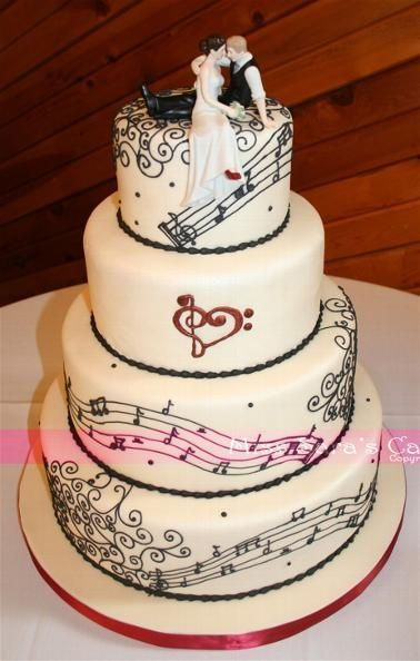 Music Lovers wedding cake with our Look of Love Topper (http://www.weddingfavorsunlimited.com/the_look_of_love_wedding_cake_topper.html)