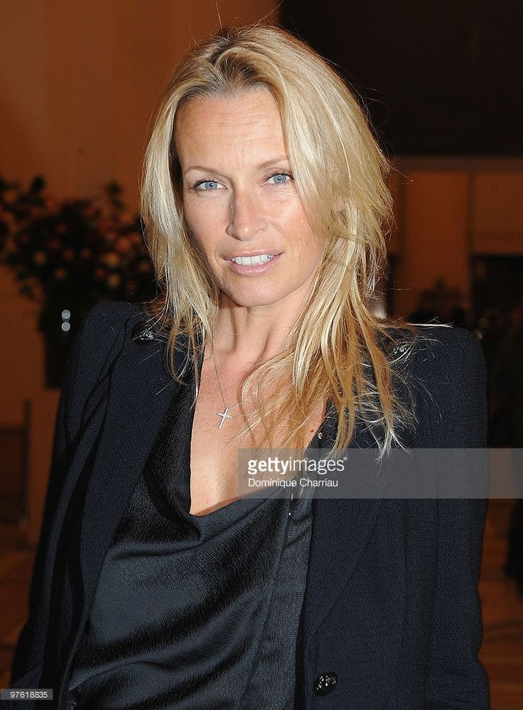 Former Model Estelle Lefebure attends the Yves Saint-Laurent Exhibition Launch…