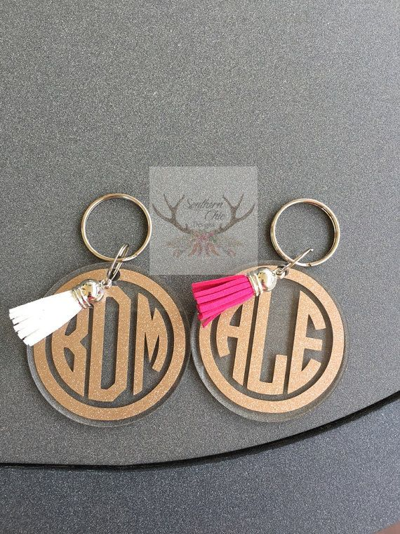 Please choose what color glitter you would like and if you decided on tassel then tell me a color choice you would like.  Can also be done in the lilly p print just message me. Super cute Glitter monogram keychain! This is one of my favorite designs The Keychain measures in diameter 2.5 inches  Be sure to tell me what color glitter background and color font you would like! First,last, middle   Personalized acrylic key chains make great gifts for any occasion; birthdays, teacher…
