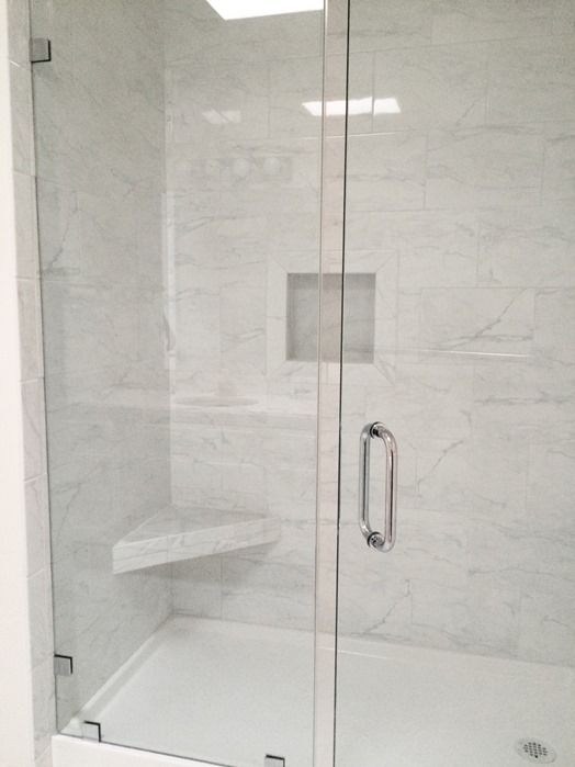 marble tile walk in shower frameless shower door  the tile is Daltile  Marissa Cararra. Top 25  best Frameless shower doors ideas on Pinterest   Glass