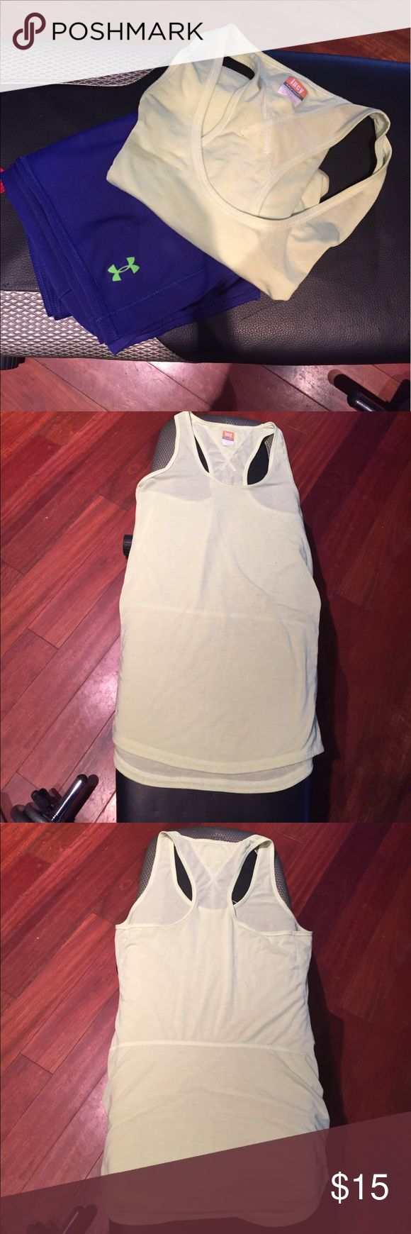 Lucy Athletic Tank Great tunic length athletic tank. Looks great with Under Armour Capri! Capri sold separately. Lucy Tops Tank Tops