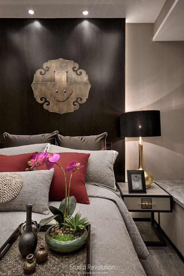 Elegant Asian-inspired decorative elements create a restful bedroom.