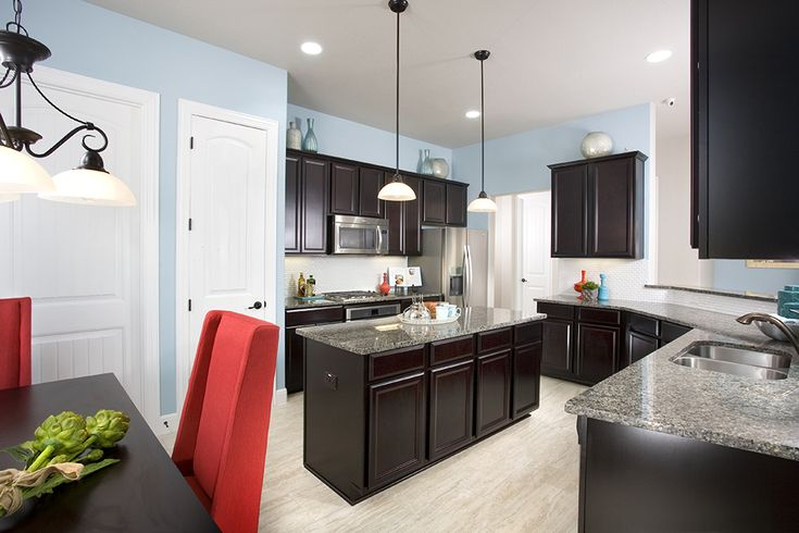Gehan homes kitchen light blue walls red accents dark for Grey kitchen cabinets with red walls