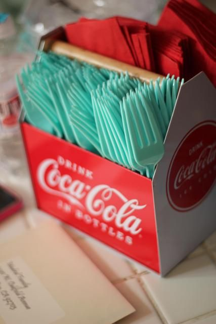 A Coca-Cola cutlery dispenser could be a great addition to a picnic or buffet style wedding reception. Retro, vintage Coca-Cola wedding inspiration.