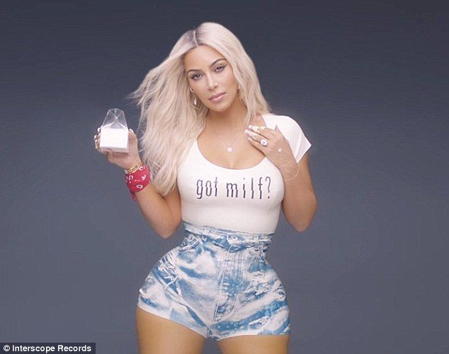 Suspicious? Kim Kardashian sparked speculation that her waist and hips had been Photoshopped in Fergie's MILF$ music video