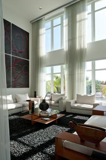 Love the tall windows and curtains and high wall decor