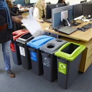 Assorted office recycling bins.