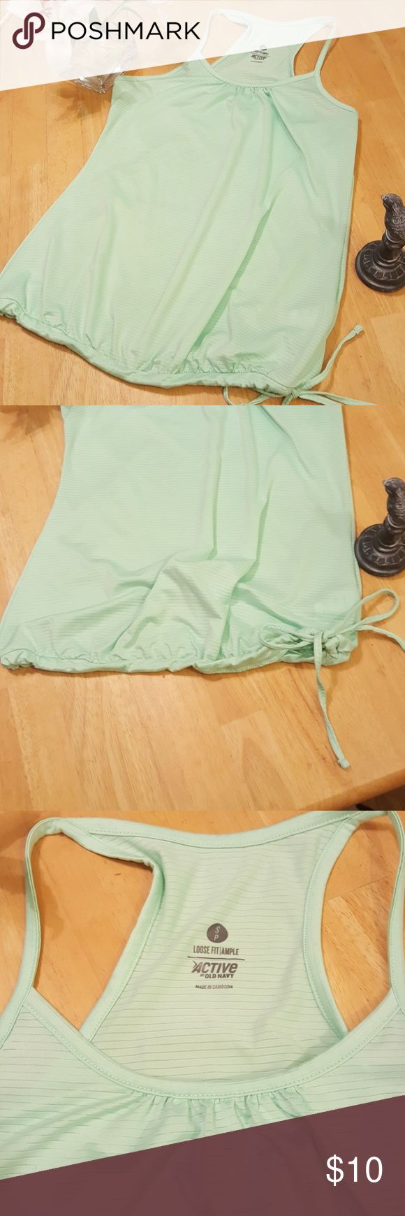Active workout shirt Mint green active workout tang top with adjustable tie on bottom. very cute and comfortable only worn once! Old navy size S/P length 24 inches. Old Navy Tops