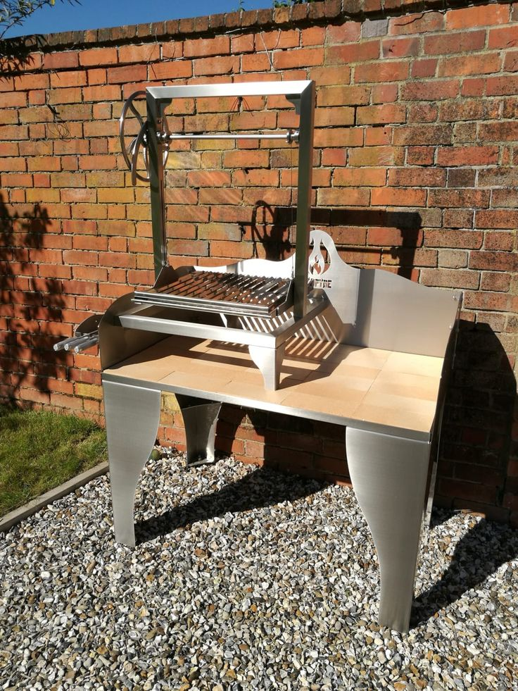 Argentinian Style Parilla Grill Asado Saltero on a Small Fire Table