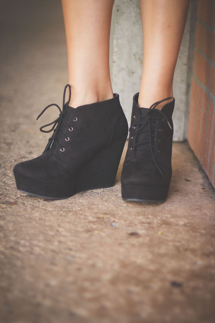 Lace-up wedge booties are perfect for any occasion. Dress them down for an afternoon out with the girls or dress them up for a night on the town! *Laces ensure the perfect fit! *Rounded closed toe *Small platform in front and about 3 in. heel *Also a