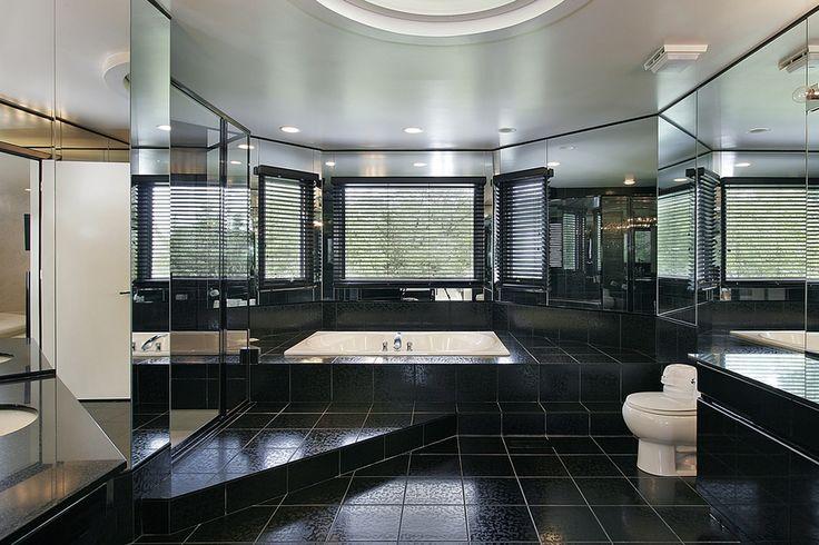 Huge luxury all-black bathroom with sunken bath tub