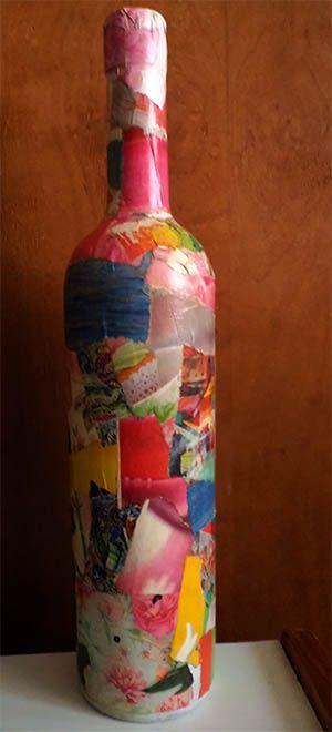 botella decorada con papeles