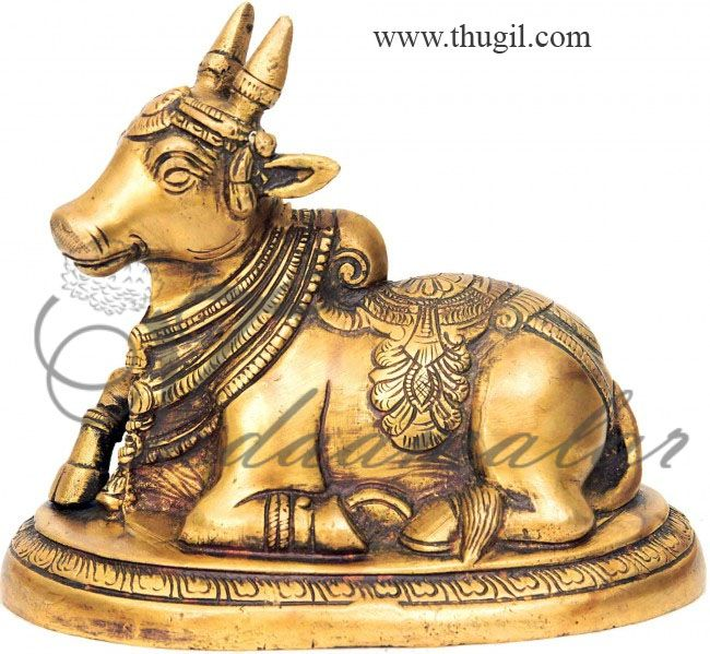 """3"""" Sacred Nandhi Bull Statue brass vehicle of Shiva  he name for the bull which serves as the mount (Sanskrit: Vahana) of the god Shiva and as the gatekeeper of Shiva and Parvati. In Hindu Religion, he is the chief guru of eighteen masters (18 siddhas) including Patanjali and Thirumular Temples venerating Shiva display stone images of a seated Nandi, generally facing the main shrine.  Nandi statues signifies single-minded devotion and the peaceful strength of faith."""