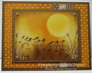 handmade card: Wetlands 2 – Stampin' Up! Card Tutorial #614 by Michellle Zindorf ...gorgeous wetlands scene ... brayering and stamping ... golden tones ... big sun ... like the partial braying of the embossing folder texture to add interest and soften the So Saffron paper ... another gorgeous work of art from Michelle! ... Stampin' Up!