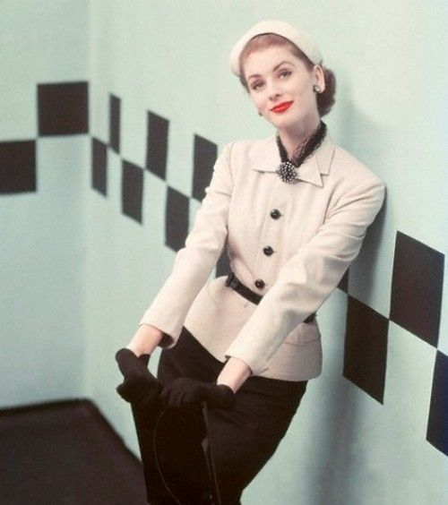 Suzy Parker in a suit, photographed by Richard Rutledge, 1952.