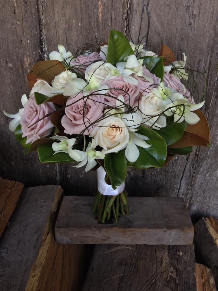 vintage pink and ivory roses with orchids magnolia and dodda vine  created by Lovely Bridal Blooms