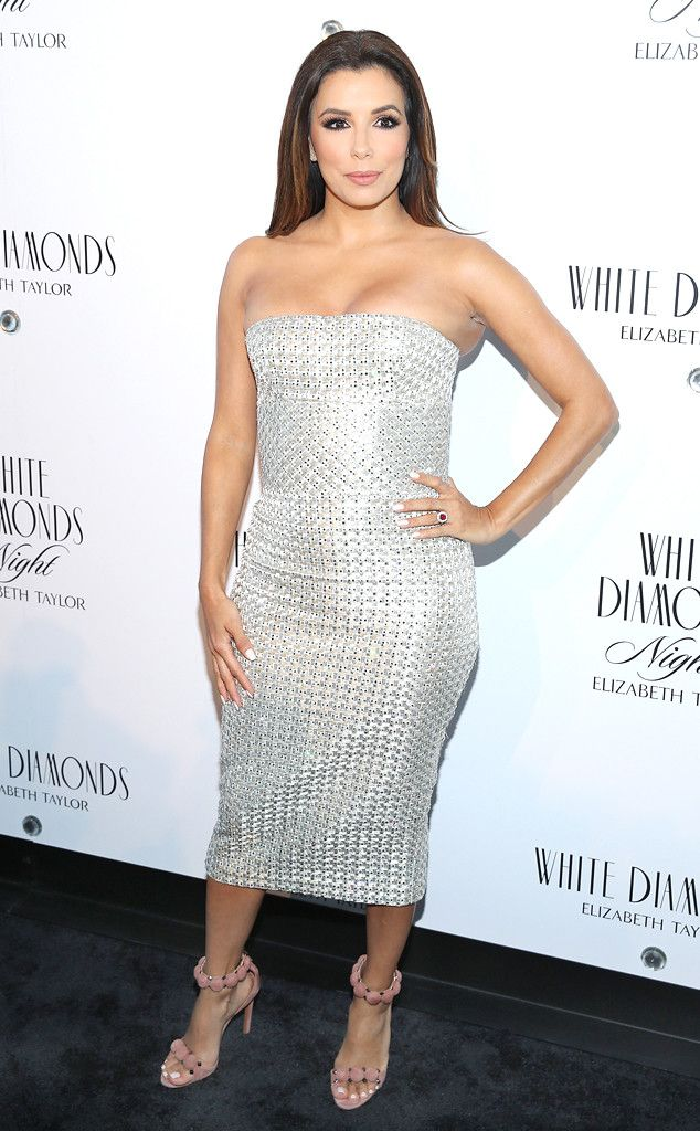 Razzle Dazzle from Fashion Police  Eva Longoria dazzles in a curve-hugging strapless gown paired with Alaïa pom-pom heels the Elizabeth Taylor White Diamonds 25th Anniversary celebration in New York. It really doesn't get much better than this!