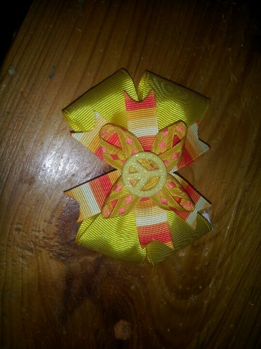 Yellow and orange peace sign bow