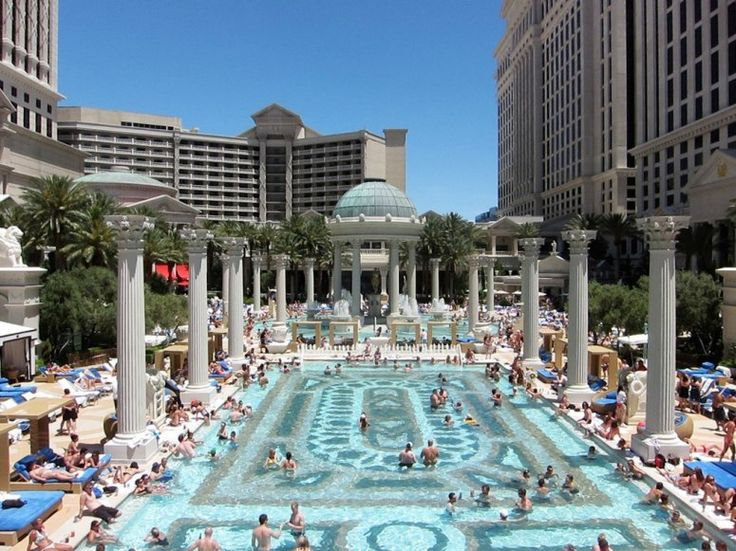 The garden of the gods pool complex at caesars palace has for Caesars swimming pool
