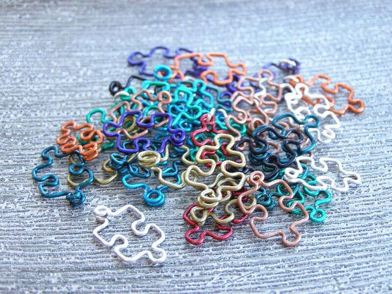 Custom Puzzle Pendants in an Assortment of Colors by DragonNerd on etsy