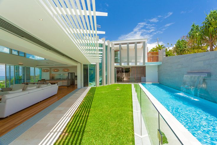 Chris Clout Design contemporary modern beach house at Coolum beach with lighting landscaping pool and great interiors