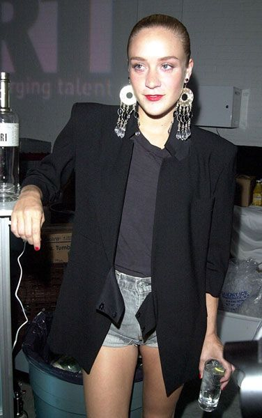 my fashion icon: Chloë Sevigny -- perfect outfit. Cutoffs, oversized black blazer, simple t, statement earrings
