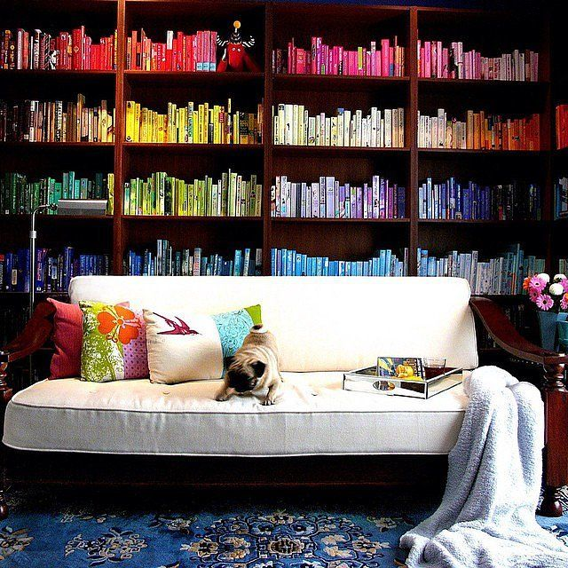 When struggling to find the right place to create your library, a great option is your living room. Put bookshelves behind your couch if you don't have lots of space.