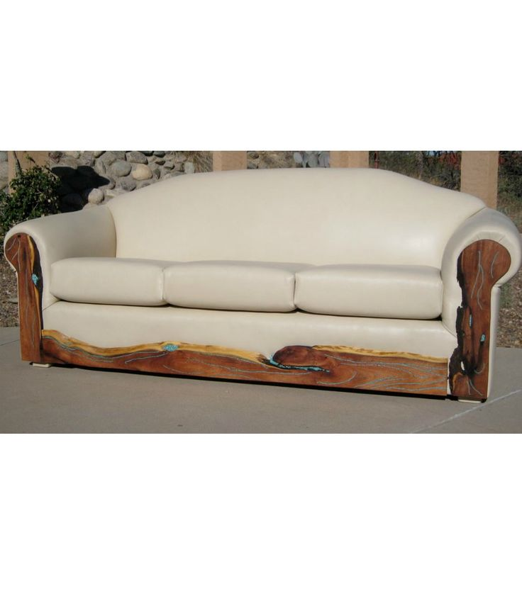 Western/Southwestern style sofa with genuine turquoise inlaid on the wood base, Pendleton wool seat cushions and smooth leather back and arms. Customizable.