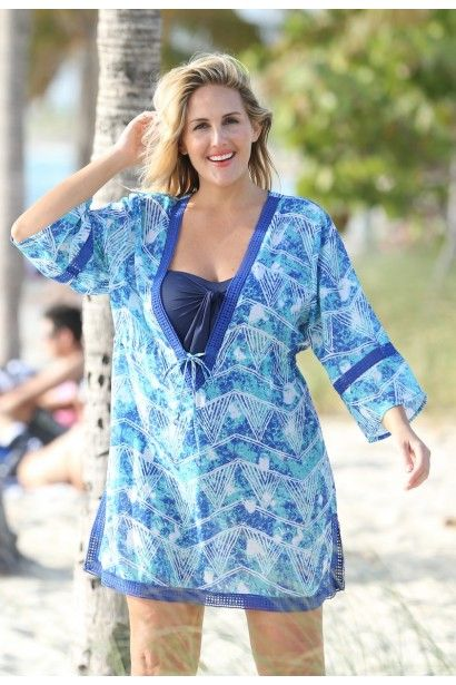 eefc61facb This lightweight women's plus size cover-up features a V-Neck, cinching  detail