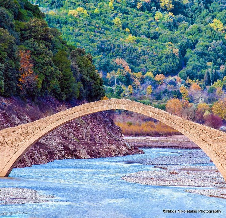 """Manoli's bridge"" in Evritania. A very special attraction a sight that never shows the same image to the visitor.  It was built in 1659 by Manolis Chrysiotis. It was used continuously for 3 centuries as the only passage from Karpenissi to western Central Greece until the construction of Kremasta bridge. Happy month!"