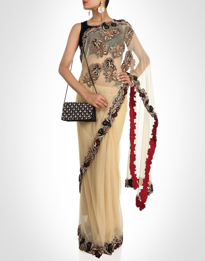 This elegant cream net sari is crafted with zardosi embroidered appliqué for an impactful finish.SHOP NOW@ www.kimaya.in
